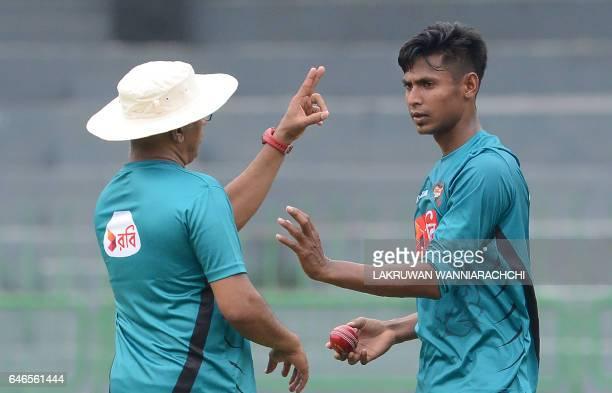 Bangladesh cricket coach Chandika Hathurusingha gives instructions to cricketer Mustafizur Rahman during a practice session at the R Premadasa...