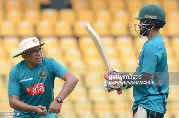 Bangladesh cricket coach Chandika Hathurusingha gives instructions to cricketer Tamim Iqbal during a practice session at the R Premadasa Stadium in...