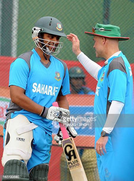 Bangladesh cricket coach Richard Pybus gestures while talking with cricketer Tamim Iqbal during a training session on the eve of the ICC Twenty20...