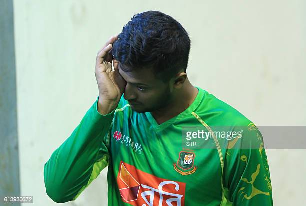 Bangladesh cricket player Shakib Al Hasan reacts during a practice session at Zahur Ahmed Chowdhury Stadium in Chittagong on October 11 ahead of the...