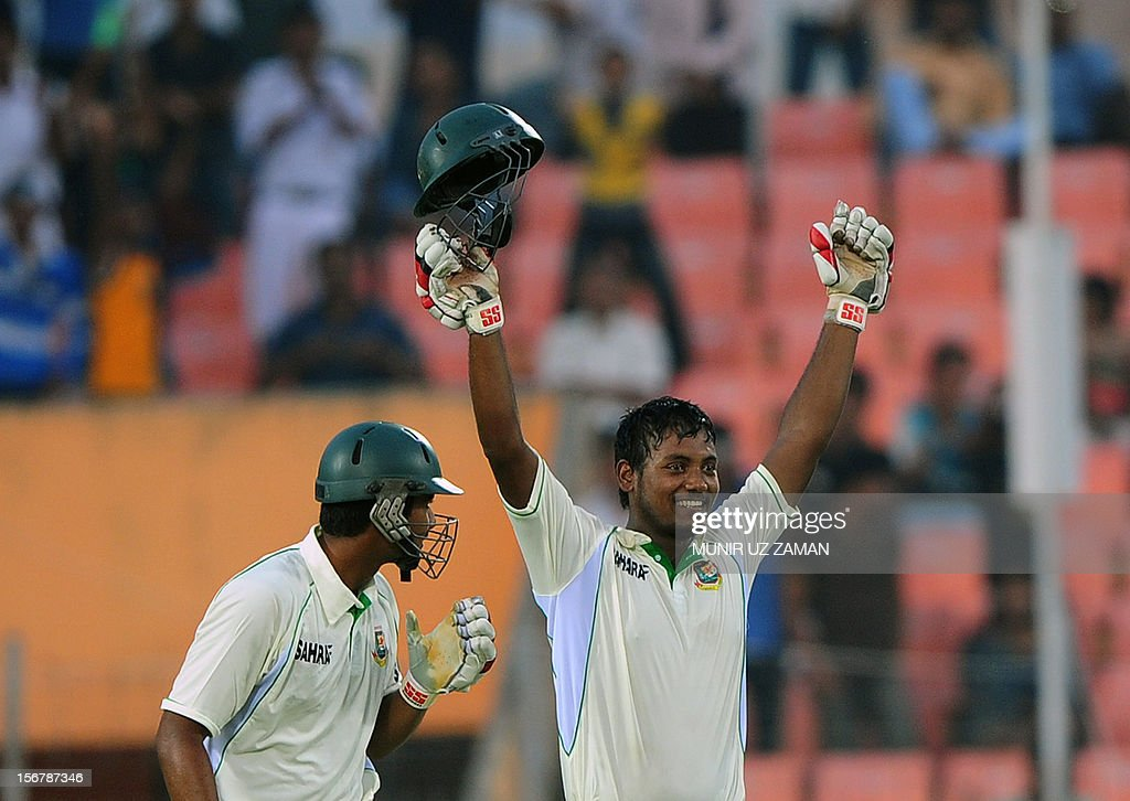 Bangladesh cricketer Abul Hasan (R) acknowledges the crowd after scoring a century as his teammate Mohammad Mahmudullah (L) looks on during the first day of the second cricket Test match between Bangladesh and The West Indies at the Sheikh Abu Naser Stadium in Khulna on November 21, 2012. AFP PHOTO/ Munir uz ZAMAN