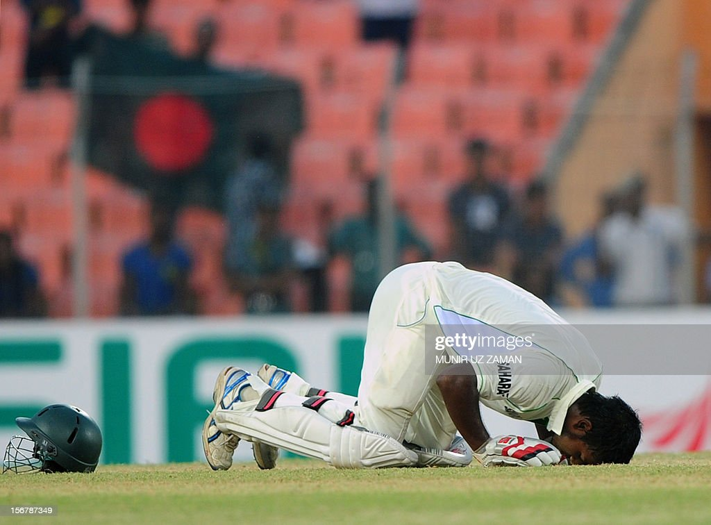 Bangladesh cricketer Abul Hasan bows after scoring a century during the first day of the second cricket Test match between Bangladesh and The West Indies at the Sheikh Abu Naser Stadium in Khulna on November 21, 2012. AFP PHOTO/ Munir uz ZAMAN
