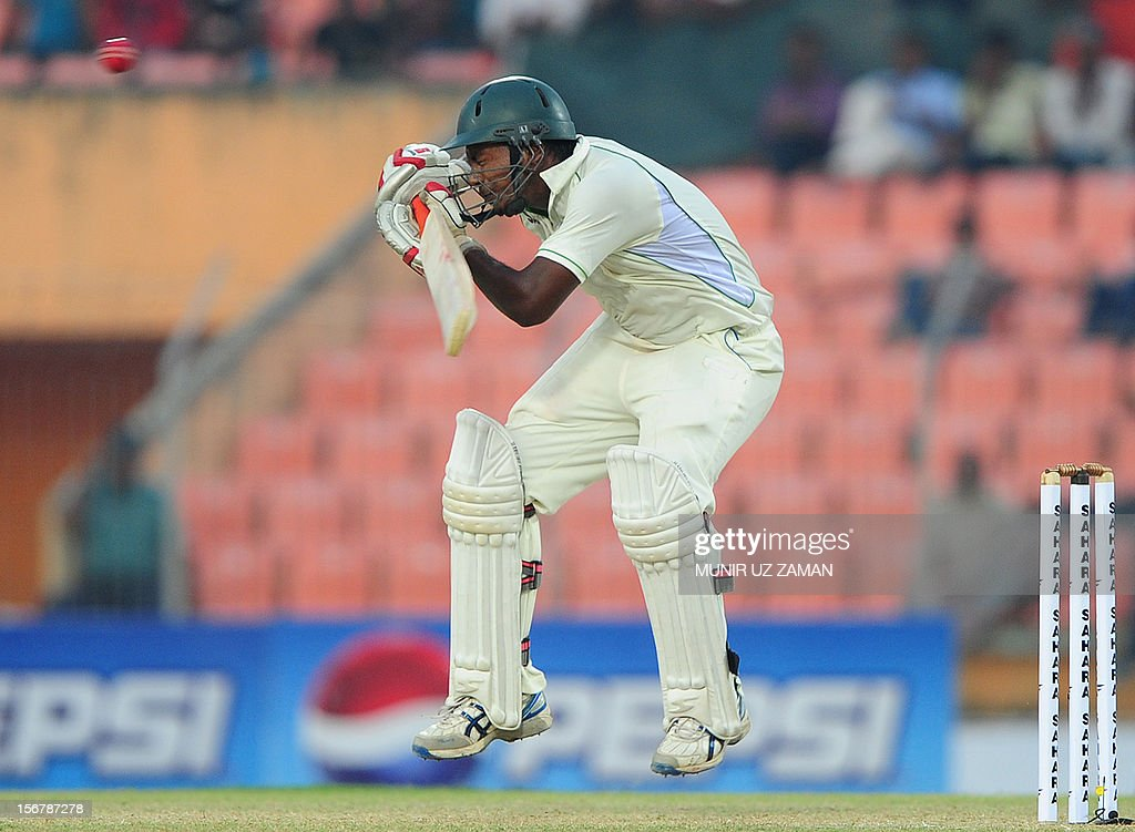 Bangladesh cricketer Abul Hasan tries to avoid a bouncer from West Indies cricketer Fidel Edwards during the first day of the second cricket Test match between Bangladesh and The West Indies at the Sheikh Abu Naser Stadium in Khulna on November 21, 2012. AFP PHOTO/ Munir uz ZAMAN