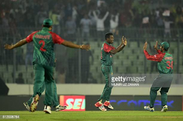 Bangladesh cricketer AlAmin Hossain celebrates with teammates after the dismissal of unseen Indian batsman Shikhar Dhawan during a Twenty 20 match...