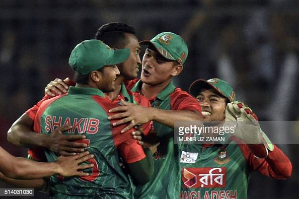 Bangladesh cricketer AlAmin Hossain celebrates with teammates after the dismissal of Indian cricketer Rohit Sharma during the Asia Cup T20 cricket...