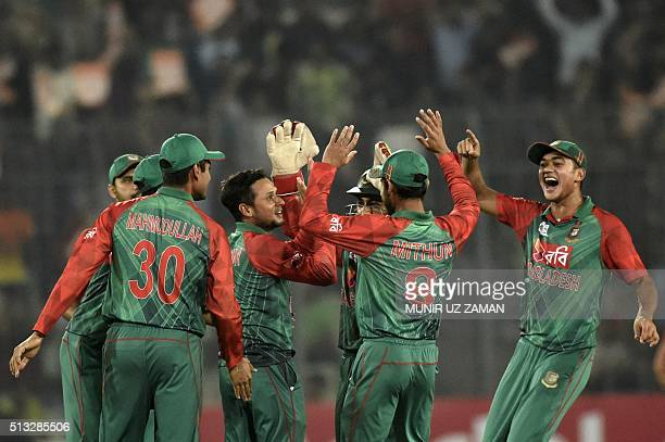 Bangladesh cricketer Arafat Sunny celebrates with teammates after the dismissal of unseen Pakistan batsman Sharjeel Khan during the Asia Cup T20...