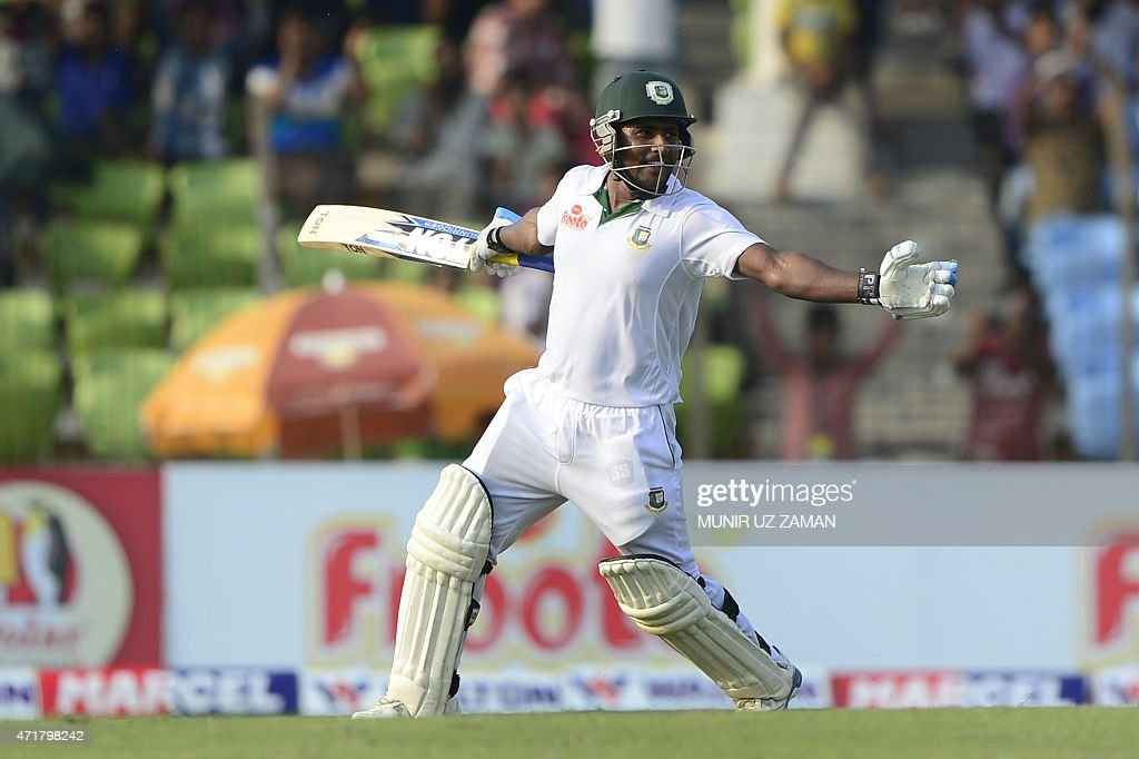 Bangladesh cricketer <a gi-track='captionPersonalityLinkClicked' href=/galleries/search?phrase=Imrul+Kayes&family=editorial&specificpeople=5565752 ng-click='$event.stopPropagation()'>Imrul Kayes</a> celebrates scoring a century (100 runs) during the fourth day of the first cricket Test match between Bangladesh and Pakistan at The Sheikh Abu Naser Stadium in Khulna on May 1, 2015. AFP PHOTO/ Munir uz ZAMAN