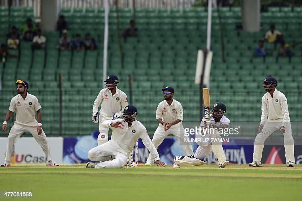 Bangladesh cricketer Imrul Kayes plays a shot as the Indian cricket captain Virat Kohli wicketkeeper Wriddhiman Saha Murali Vijay Ajinkya Rahane and...