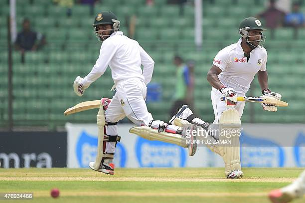 Bangladesh cricketer Imrul Kayes runs between wickets with teammate Mominul Haque during the fourth day of the Test match between Bangladesh and...