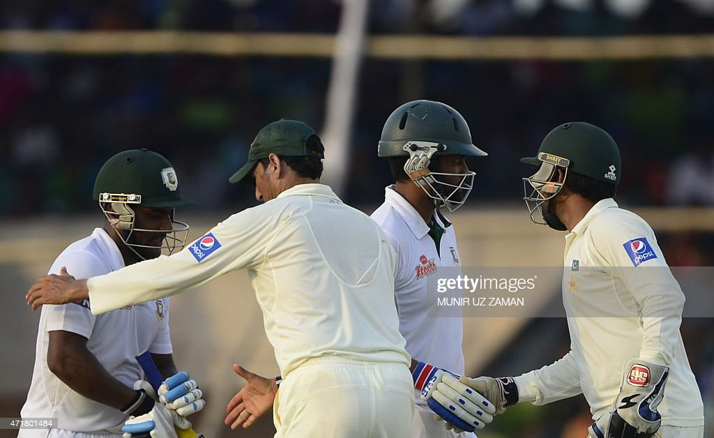 Bangladesh cricketer Imrul Kayes shakes hands with Pakistan's Younis Khan and Bangladesh's Tamiam Iqbal and Pakistan's Sarfraz Ahmed shake hands...