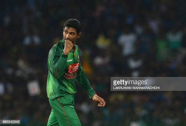Bangladesh cricketer Mahmudullah celebrates after he dismissed Sri Lankan cricketer Upul Tharanga during the second T20 international cricket match...