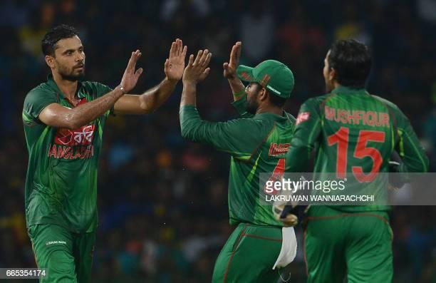 Bangladesh cricketer Mashrafe Mortaza celebrates with his teammates after he dismissed Sri Lankan cricketer Seekkuge Prasanna during the second T20...