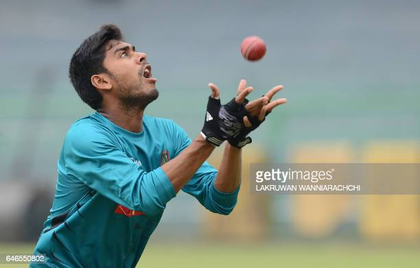 Bangladesh cricketer Mehedi Hasan catches a ball during a practice session at the R Premadasa Stadium in Colombo on March 1 2017 ahead of a Test...