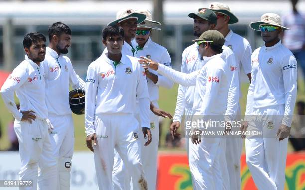 Bangladesh cricketer Mehedi Hasan celebrates with teammates after he dismissed Sri Lankan batsman Niroshan Dickwella during the second day of the...