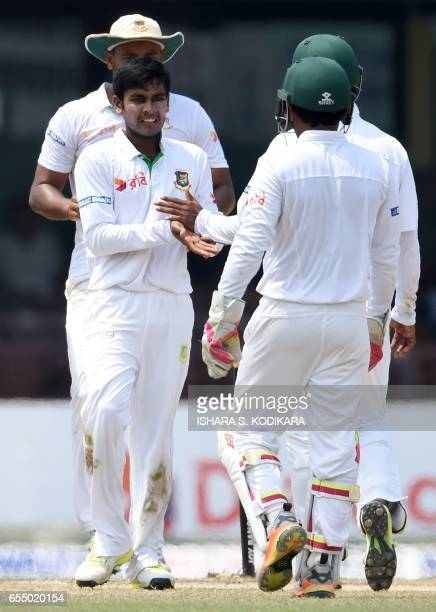 Bangladesh cricketer Mehedi Hasan celebrates with teammates after he dismissed Sri Lankan batsman Dilruwan Perera during the fifth and final day of...