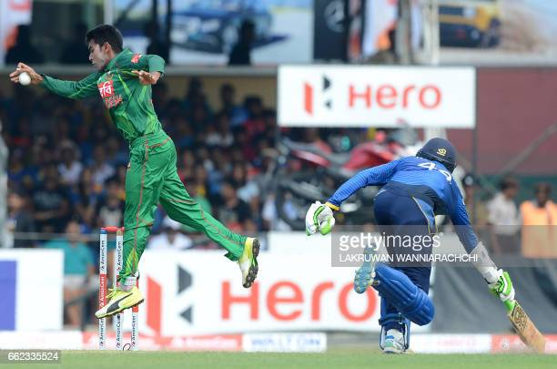 Bangladesh cricketer Mehedi Hasan throws the ball in an attempt to unsuccessfully run out Sri Lankan cricketer Upul Tharanga during the third and...