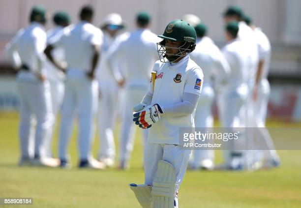 Bangladesh cricketer Mominul Haque walks back to the pavilion after his dismissal by South Africa's Kagiso Rabada during the third day of the second...