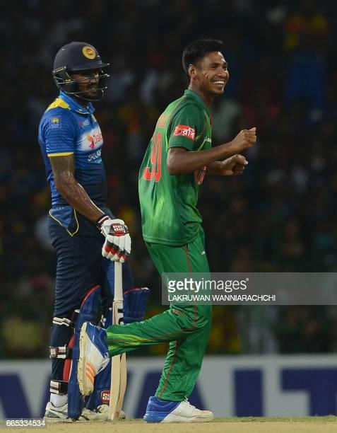 Bangladesh cricketer Mustafizur Rahman celebrates after he dismissed Sri Lankan cricketer Asela Gunaratne during the second T20 international cricket...
