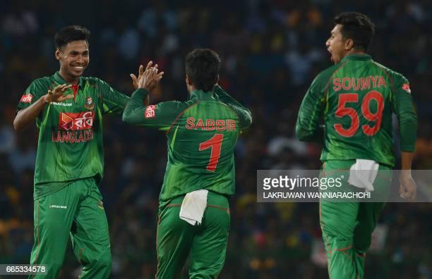 Bangladesh cricketer Mustafizur Rahman celebrates with his teammates after he dismissed Sri Lankan cricketer Asela Gunaratne during the second T20...