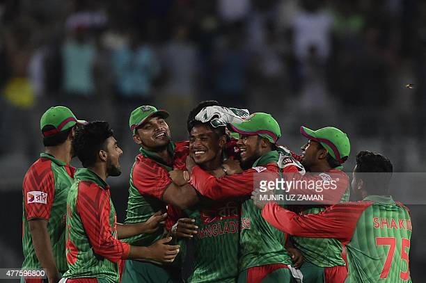 Bangladesh cricketer Mustafizur Rahman celebrates with teammates after the dismissal of the Indian cricketer Ravindra Jadeja during the first One Day...