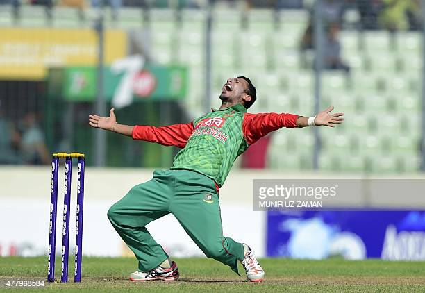 Bangladesh cricketer Nasir Hossain appeals successfully for leg before wicket decision against Indian cricketer Virat Kohli during the second One Day...