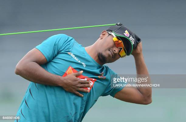 Bangladesh cricketer Rubel Hossain stretches during a practice session at the R Premadasa Stadium in Colombo on March 1 2017 ahead of a Test series...