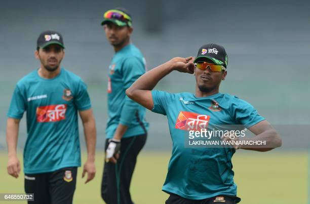 Bangladesh cricketer Rubel Hossain throws a ball as teammates look on during a practice session at the R Premadasa Stadium in Colombo on March 1 2017...