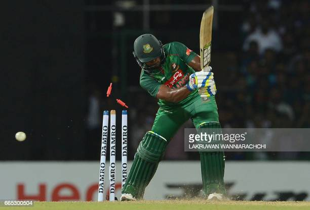 Bangladesh cricketer Sabbir Rahman gets dismissed by Sri Lankan cricketer Vikum Sanjaya during the second T20 international cricket match between Sri...
