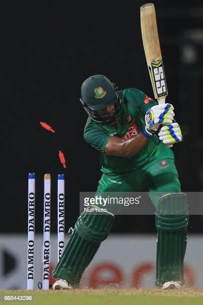 Bangladesh cricketer Sabbir Rahman gets dismissed by Sri Lankan cricketer Vikum Sanjaya during the 2nd and final T20 International cricket match...