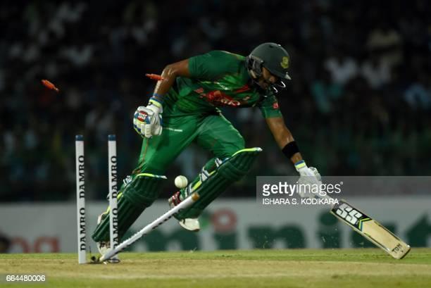 Bangladesh cricketer Sabbir Rahman is run out during the first T20 international cricket match between Sri Lanka and Bangladesh at The R Premadasa...