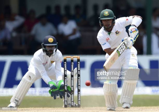 Bangladesh cricketer Sabbir Rahman plays a shot as Sri Lankan wicketkeeper Niroshan Dickwella looks onduring the fifth and final day of the second...