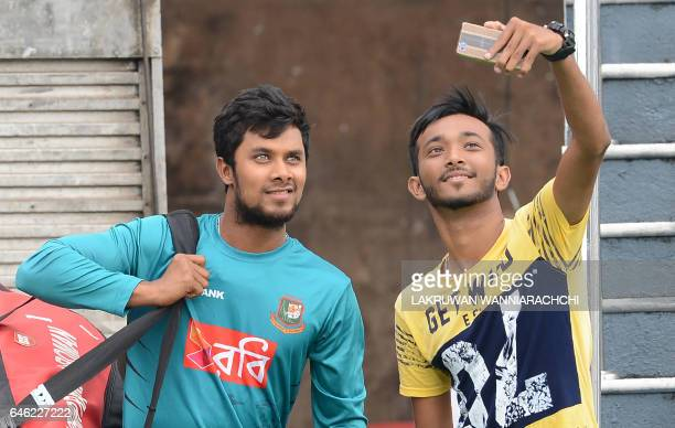 Bangladesh cricketer Sabbir Rahman poses for a selfie with cricket fan during a practice session at The R Premadasa Stadium in Colombo on February 28...