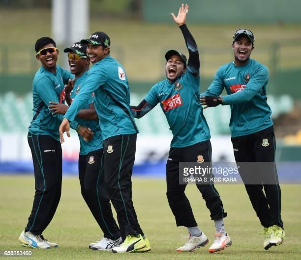 Bangladesh cricketer Sabbir Rahman shares a light moment with teammates Mushfiqur Rahim Soumya Sarkar Rubel Hossain and Mosaddek Hossain during a...