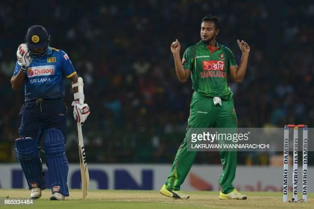 Bangladesh cricketer Shakib Al Hasan celebrates after he dismissed Sri Lankan cricketer Dilshan Munaweera during the second T20 international cricket...
