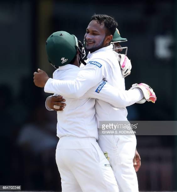 Bangladesh cricketer Shakib Al Hasan celebrates with captain Mushfiqur Rahim after he dismissed Sri Lankan cricketer Niroshan Dickwella during the...