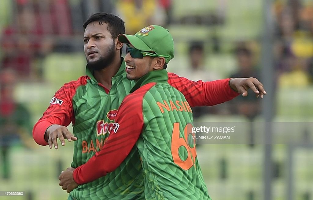 Bangladesh cricketer <a gi-track='captionPersonalityLinkClicked' href=/galleries/search?phrase=Shakib+Al+Hasan&family=editorial&specificpeople=4145971 ng-click='$event.stopPropagation()'>Shakib Al Hasan</a> (L) celebrates with teammate <a gi-track='captionPersonalityLinkClicked' href=/galleries/search?phrase=Nasir+Hossain&family=editorial&specificpeople=4879926 ng-click='$event.stopPropagation()'>Nasir Hossain</a> after the dismissal of Pakistan cricketer Mohammad Rizwan during the second One Day International cricket match between Bangladesh and Pakistan at the Sher-e-Bangla National Cricket Stadium in Dhaka on April 19 , 2015. AFP PHOTO/ Munir uz ZAMAN