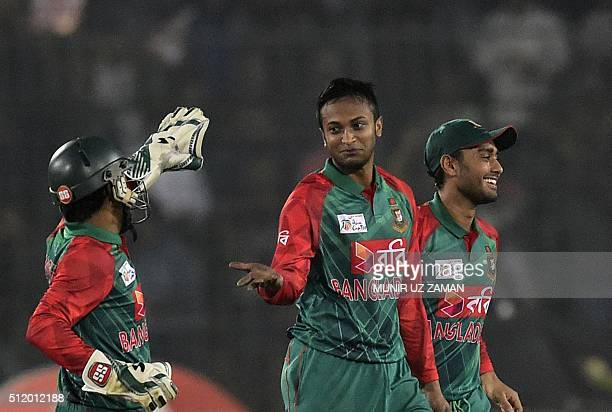 Bangladesh cricketer Shakib Al Hasan celebrates with teammates after the dismissal of unseen Indian batsman Yuvraj Singh during a Twenty20 cricket...