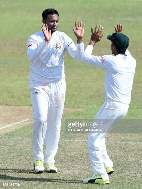 Bangladesh cricketer Shakib Al Hasan celebrates with teammates after he dismissed Sri Lankan cricketer Niroshan Dickwella during the first day of the...