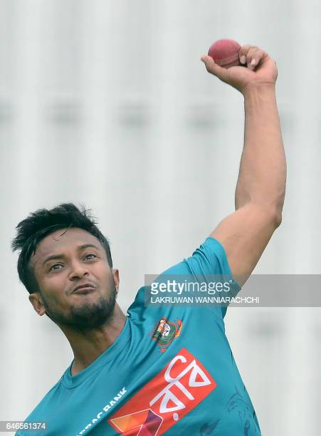 Bangladesh cricketer Shakib Al Hasan delivers a ball during a practice session at the R Premadasa Stadium in Colombo on March 1 2017 ahead of a Test...
