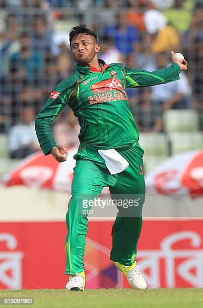 Bangladesh cricketer Shakib Al Hasan delivers a ball during the first one day international cricket match between Bangladesh and England at the...