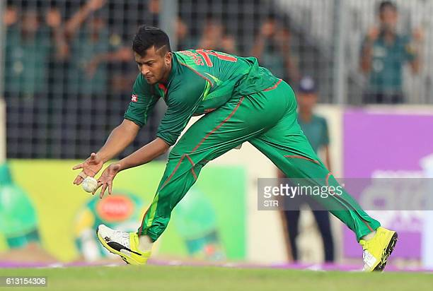 Bangladesh cricketer Shakib Al Hasan fields a ball during the first one day international cricket match between Bangladesh and England at the...