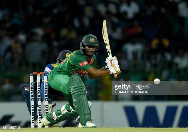 Bangladesh cricketer Shakib Al Hasan plays a shot during the first T20 international cricket match between Sri Lanka and Bangladesh at the R...