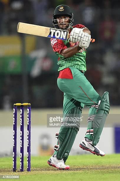 Bangladesh cricketer Shakib Al Hasan plays a shot during the second ODI cricket match between Bangladesh and India at the ShereBangla National...