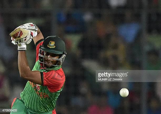 Bangladesh cricketer Shakib Al Hasan plays a shot during the T20 match between Bangladesh and Pakistan at the ShereBangla National Cricket Stadium in...