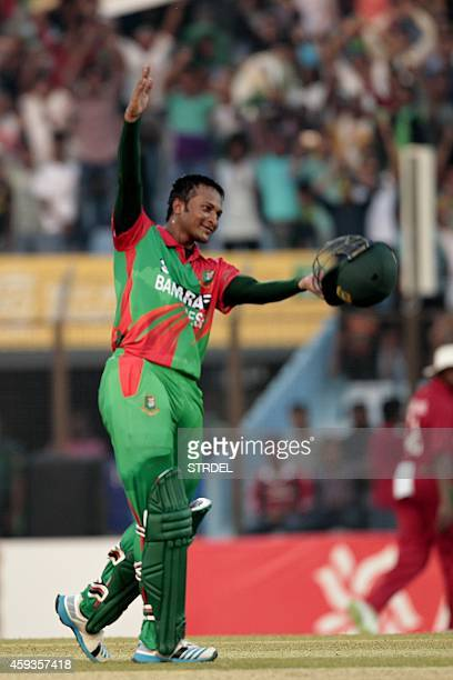Bangladesh cricketer Shakib Al Hasan reacts after scoring a century during the first one day international match between Bangladesh and Zimbabwe at...