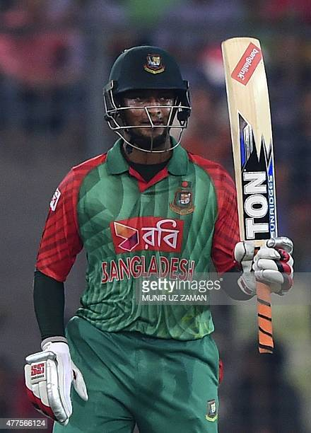 Bangladesh cricketer Shakib Al Hasan reacts after scoring a half century during the first one day international cricket match between Bangladesh and...