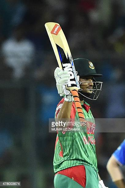 Bangladesh cricketer Shakib Al Hasan reacts after scoring a half century during the second ODI cricket match between Bangladesh and India at the...