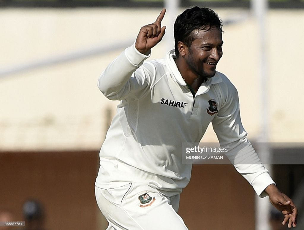 Bangladesh cricketer Shakib Al Hasan reacts after the dismissal of Zimbabwean batsman Natsai M'shangwe during the fifth day of the second cricket...