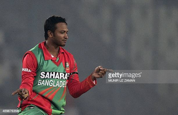 Bangladesh cricketer Shakib Al Hasan reacts after the dismissal of Zimbabwe criketer Vusi Sibanda during the fourth oneday international match...