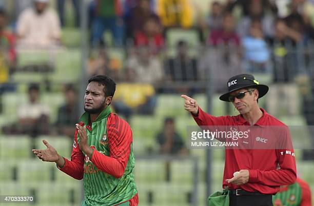 Bangladesh cricketer Shakib Al Hasan reacts after the dismissal of the Pakistan cricketer Mohammad Rizwan during the second One Day International...